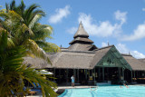 Thatched lobby building opening up onto the main pool, Shandrani Hotel, Mauritius