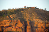 Cliffs honeycombed with caves west of central Xining