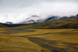 Tibetan plateau with snow covered mountains