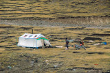 Tibetan tent with a man and a motorbike