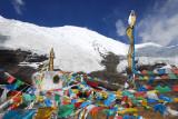 Prayer flag covered stupa beneath Mt Nojin Kangtsang