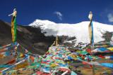 Stupa, prayer flags and glacier, Karo-la Pass