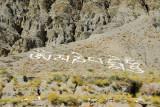The Buddhist mantra Om Mani Padme Hum written in white stone