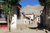A dusty side street leading deeper into old town Gyantse from Pelkor Road