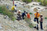 Curious Tibetan laborers at Tsechen Monastery