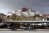 Shigatse Dzong rising behind the tourist market