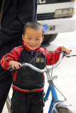 Small boy with a bike, Shigatse