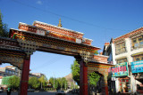 Tibetan style gate to the touristy Buxing Jie leading to Tashilhunpo Monastery