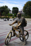 Statue of a boy ona mountain bike with a t-shirt reading Zhongguo (China)