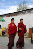 Tibetan monks walking outside Tashilhunpo Monastery