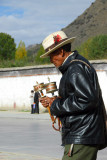 Tibetan man doubling his luck with 2 prayer wheels