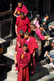 Monks leaving the assembly hall
