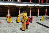 Monks gathering in the courtyard of Kelsang Temple Complex for noon prayers