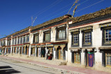 Shegar's main street lined with traditional Tibetan houses