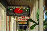 Painted wood shop signs along Front Street, Lahaina's main drag