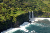 A double waterfall plunging over the cliff directly onto Kea'a Beach, Maui