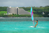 Windsurfing Tumon Bay with the Nikko Hotel in the background