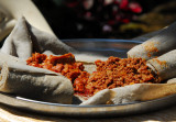 Typical Ethiopian meal - spicy meat and injera bread