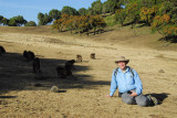 Keith with a troop of Gelada grazing in the shade