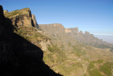 Stunning view from a cut in rock to the steep cliffs of Imet Gogo and Inatye