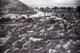 Historic photo of the Stelae field surrounded by huts
