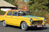 An old yellow Peugeot decorated for another wedding