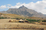 Village of thatched huts with the mountain of Ashetan Maryam