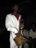 Azmari (Ethiopian minstrel) playing a masenqo