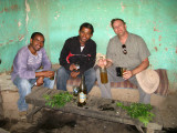 Keith with the guide and driver at the Tej House in Axum