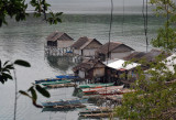 Fishermen's huts with their outrigger banca canoes, Culion