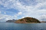 White sand beach on a small island between Apo and Uson Islands