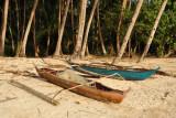 Outrigger canoes along Corong-Corong Beach