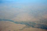 Farmland along the Great Zab River, Iraqi Kurdistan, with Erbil in the distance
