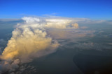 Early morning thurnderstorm off the southern tip of Borneo (S04/E115)