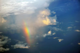 Rainbow at the base of a thunderstorm off Borneo, Indonesia