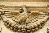 Eagle, reminiscent of Imperial Rome, on either side of the central portal to St. Peter's Basilica