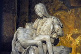 Ever since a nut (Australian) attacked the Pietà in 1972, it's been kept behind glass