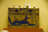 Wooden box painted with Anubis in the form of a jackal containing four canopic jars