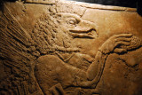 Eagle-headed winged figure worshiping the Sacred Tree, Assyrian from the reign of Ashurnasirpal II (883-859 BC)