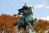 Kusunoki Masashi statue with fall foliage, Tokyo