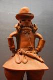 Haniwa man in formal attire, terra-cotta tomb ornament, Kofun period 6th C.