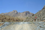 The new paved road runs above the wadi