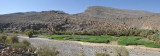 Panorama with Wadi Ghul, the ruins of the ancient village of Ghul and Jabal Shams