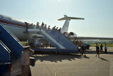 Deplaning by stairs on a warm summer day in Pyongyang
