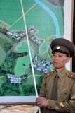 A North Korean officer explains the JSA layout