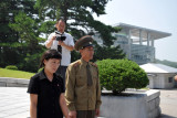 North Korean officer and the English translater being filmed by our group's cameraman