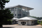 The South Korean House of Freedom behind one of the 7 meeting rooms straddling the border