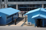 The border between North and South Korea runs through the middle of each of the blue huts