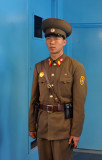 DPRK soldier on the ROK side of the hut guarding the southern door