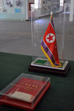 Flag of the DPRK delegation on the original table